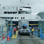Getting on the ferry can be nerve-wracking because the causeway is narrow and they pack you in inches from each other and from the walls.  This is a friend of ours we met in Ketchikan who is backing his fifth wheel  onto the deck, and doing it expertly.