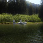 A small float plane.  The fellow set down in the wilderness to have a box lunch, then he'll be on his way, using the river as a runway.